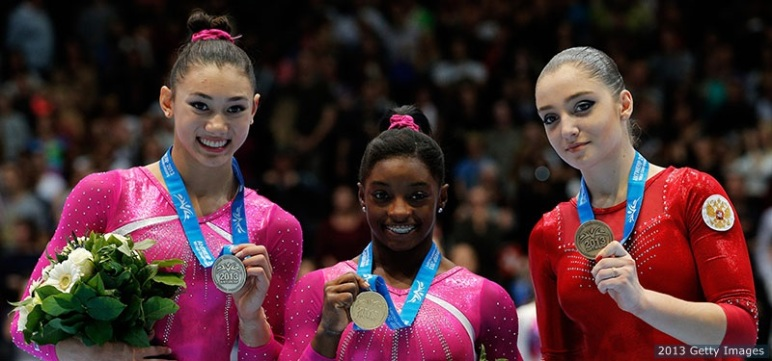 ANTWERPEN, BELGIUM - OCTOBER 04:  (L-R)  Kyla Ross (silver medal) of USA, Simone Biles (gold medal) of USA and Aliya Mustafina (bronze medal) of Russia pose after the Womens All-Round Final on Day Five of the Artistic Gymnastics World Championships Belgium 2013 held at the Antwerp Sports Palace on October 4, 2013 in Antwerpen, Belgium.  (Photo by Dean Mouhtaropoulos/Getty Images)